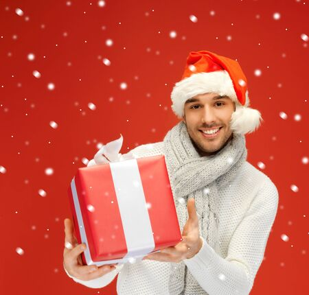 bright picture of handsome man in christmas hat Stock Photo - 16335256