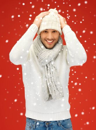 head wear: picture of handsome man in warm sweater, hat and scarf  Stock Photo