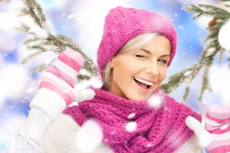 winter woman: bright picture of beautiful woman in hat, muffler and mittens