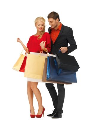 bright picture of man and woman with shopping bags Stock Photo - 16353829