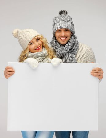 picture of family couple in a winter clothes holding blank board Stock Photo - 16353871