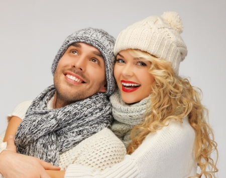 bright picture of family couple in a winter clothes Stock Photo - 16353937