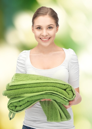 bright housekeeping: bright picture of lovely housewife with towels