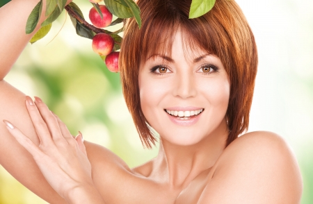 age care: picture of happy woman with apple twig