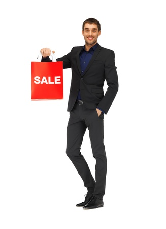 gentlemen: picture of handsome man in suit with shopping bags