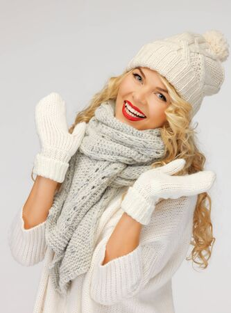 head wear: bright picture of beautiful woman in hat, muffler and mittens