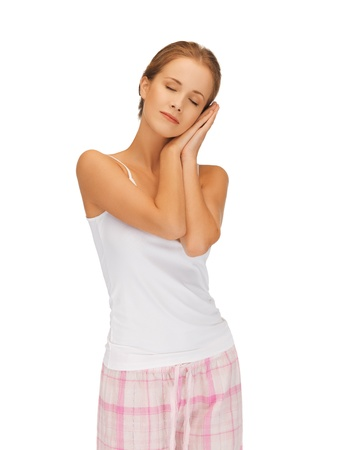 bright picture of woman in cotton pajamas with closed eyes photo