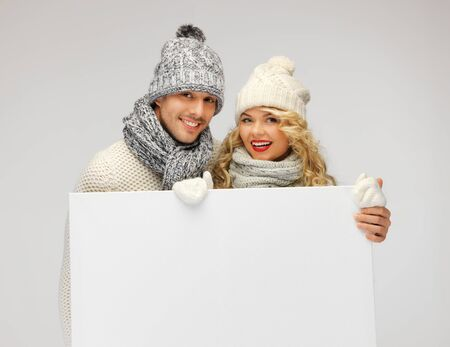 picture of family couple in a winter clothes holding blank board Stock Photo - 16411041
