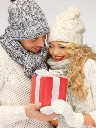attractive couple: picture of romantic couple in a sweaters with gift box