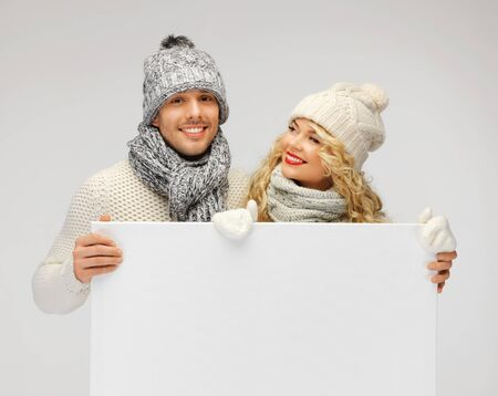 picture of family couple in a winter clothes holding blank board Stock Photo - 16391686