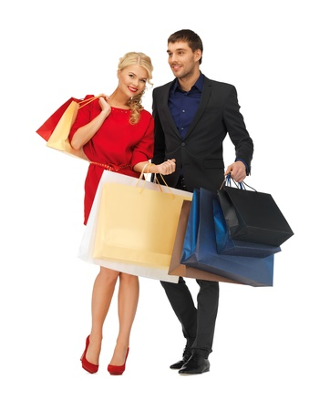 bright picture of man and woman with shopping bags Stock Photo - 16444097