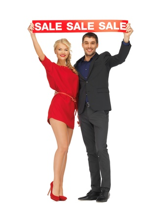 bright picture of man and woman with sale sign Stock Photo - 16444105