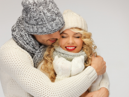bright picture of family couple in a winter clothes Stock Photo - 16444311
