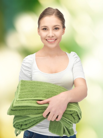 ware house: bright picture of lovely housewife with towels