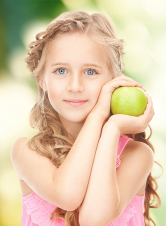 picture of little girl with green apple photo