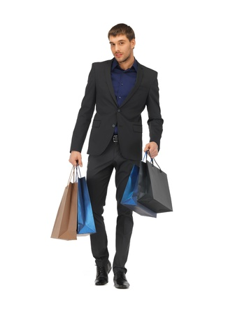 picture of handsome man in suit with shopping bags  Stock Photo - 16471109