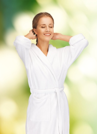 robes: picture of beautiful woman in white bathrobe Stock Photo