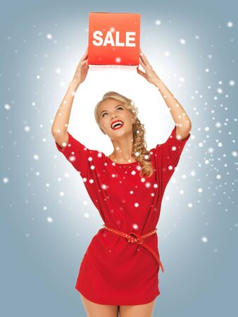 picture of lovely woman in red dress with sale sign Stock Photo - 16471880