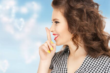 attractive gorgeous: bright picture of young woman with finger on lips