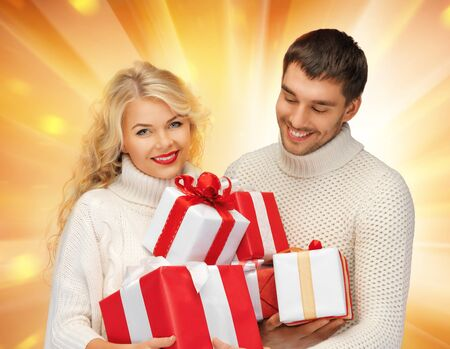 picture of family couple in a sweaters with gift boxes photo