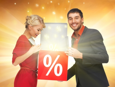 on special offer: bright picture of man and woman with percent sign