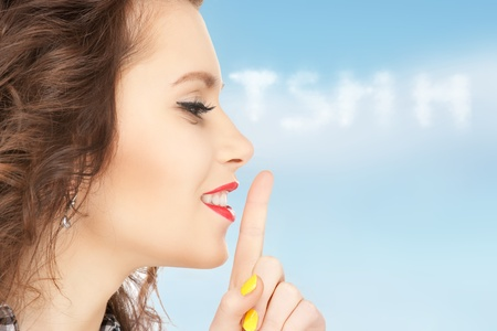 bright picture of young woman with finger on lips Stock Photo - 16494909