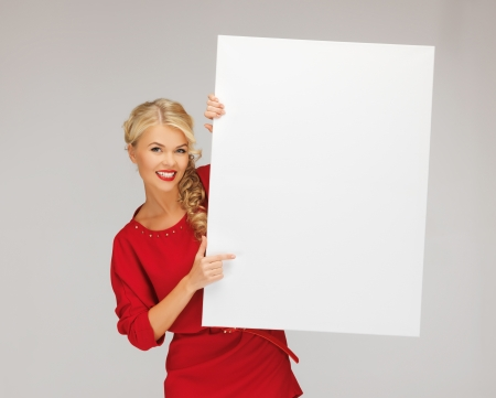 advertise: picture of lovely woman in red dress with blank board Stock Photo