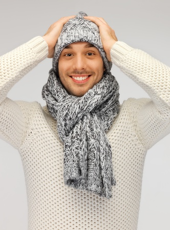 picture of handsome man in warm sweater, hat and scarf  photo
