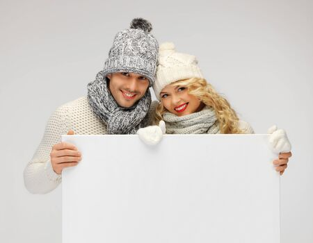 picture of family couple in a winter clothes holding blank board Stock Photo - 16494942