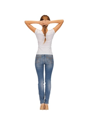 backside: rear view of woman in blank white t-shirt
