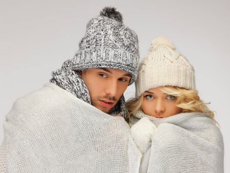 bright picture of family couple under warm blanket Stock Photo - 16494961