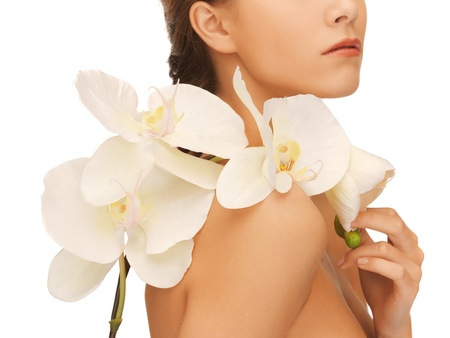 woman neck: closeup picture of woman s shoulder and hands holding orchid flower