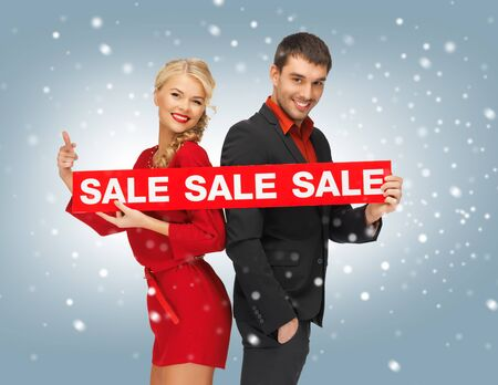 evening wear: bright picture of man and woman with sale sign