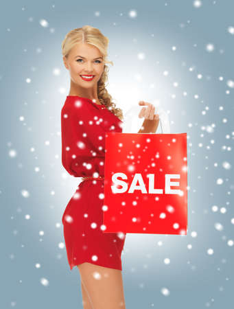 picture of beautiful woman in red dress with shopping bag photo