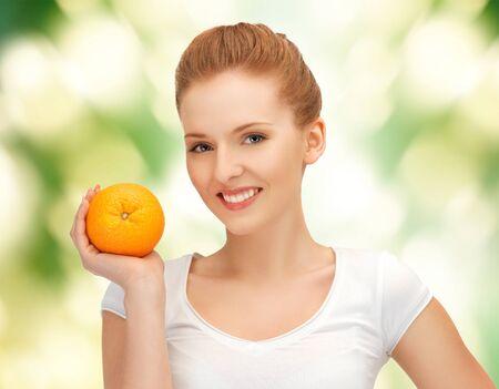 picture of beautiful teenage girl with orange  photo