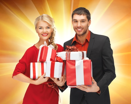 picture of man and woman with gift boxes photo