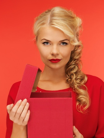 picture of lovely woman in red dress with opened gift box Stock Photo - 16549341