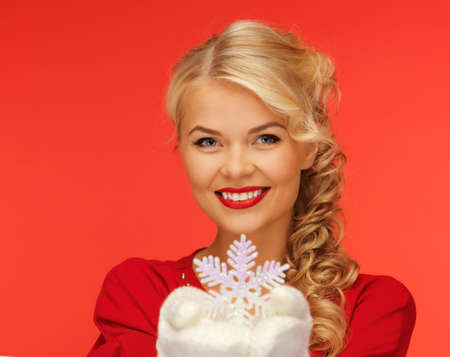 picture of lovely woman in mittens and red dress with snowflake photo