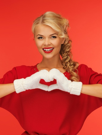 picture of lovely woman showing heart shape photo