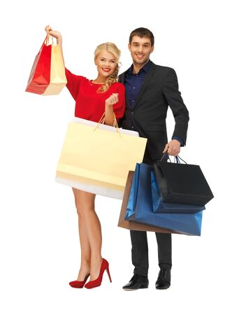 bright picture of man and woman with shopping bags photo