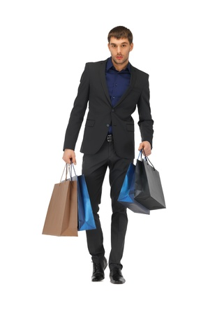 picture of handsome man in suit with shopping bags Stock Photo - 16547685