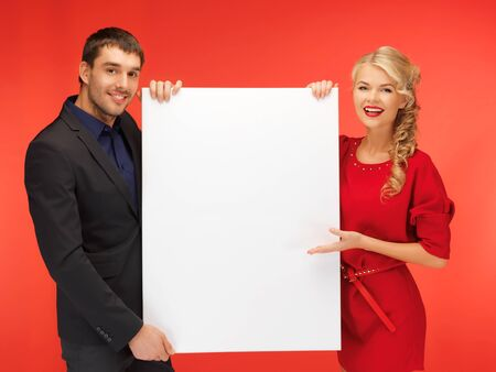 bright picture of couple holding big blank board photo