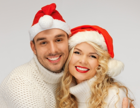 picture of family couple in sweaters and santa s hats photo