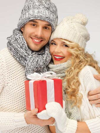 picture of romantic couple in a sweaters with gift box photo