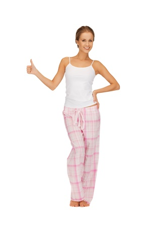 picture of woman in cotton pajamas showing thumbs up