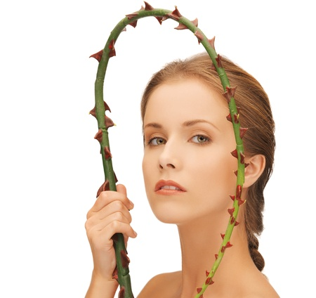 picture of lovely woman holding branch with thorns Stock Photo - 16549383