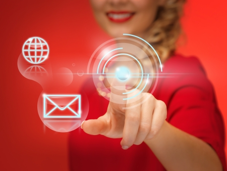 picture of lovely woman in red dress pressing virtual button Stock Photo - 16549326