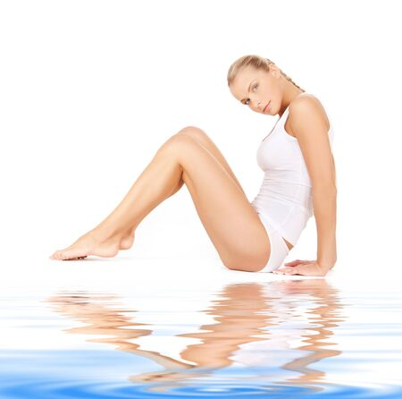 slender woman: picture of beautiful woman in cotton undrewear on white sand