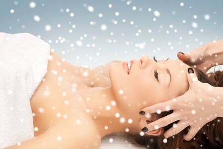 remedial: picture of beautiful woman in massage salon with snow