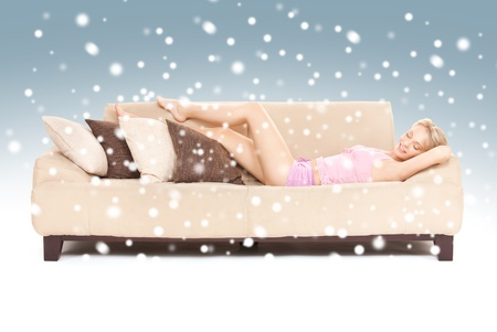 drowse: bright picture of sleeping woman on sofa with snow